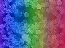 Rainbow Glitter. Background of rainbow colored bokeh and glitter Stock Image