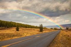 Rainbow and the Going to the Sun Road in Glacier National Park. Montana Royalty Free Stock Photos