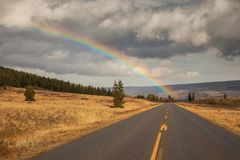 Rainbow and the Going to the Sun Road in Glacier National Park. Montana Stock Image