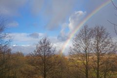 Rainbow in the golden autumn fieelds royalty free stock images