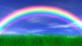 Rainbow, Grass & Peaceful Sky Stock Images