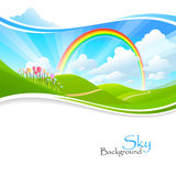 Rainbow , Green hills and Blue Sky Stock Photo