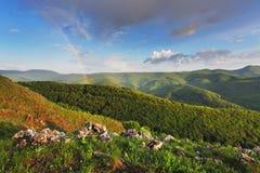 Rainbow in green mountain Stock Photo