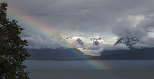 Rainbow at Grewingk Glacier. A rainbow shines in front of Grewingk Glacer in Homer Alaska Stock Photography