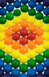 Rainbow Gumballs. Multi colored gum ball pattern Stock Photo