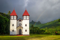 Rainbow on Haapiti church in Moorea island, landscape Royalty Free Stock Images
