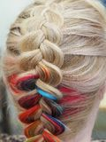 Rainbow hair in a braid. Braiding close up. stock photo