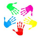 Rainbow Hands. Five hand prints of different colors in a circle pattern Royalty Free Stock Image