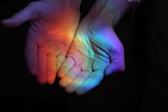 Rainbow in the hands. Bright stock photography