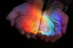Rainbow in the hands. Sun rays stock images