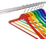 Rainbow hangers on clothes rail Royalty Free Stock Photos