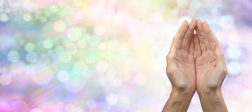 Rainbow Healing Reiki Share Banner. Female cupped hands on rainbow colored bokeh banner  background with plenty of copy space to the right Stock Image