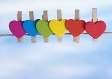 Rainbow heart against the sky. Stock Photos