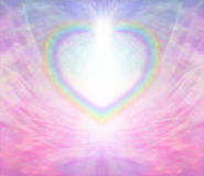 Rainbow Heart Background. Rainbow Heart shape making a border on a radiating delicate pink background with a light burst at the top of the heart stock illustration