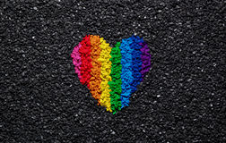 Rainbow heart on black background, gravel and shingle, LGBT colors, love wallpaper, valentine. Rainbow heart on black background, gravel and shingle, LGBT colors royalty free stock photography