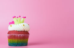 Rainbow heart crown cupcake with pink copy space Stock Images
