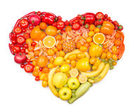 Rainbow heart of fruits and vegetables. As healthy eating concept stock photos