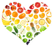 Rainbow heart of fruits and vegetables. On white background. Food concept stock photography