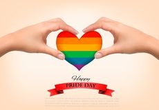 Rainbow heart shaped in hands. Gay pride concept. Vector illustration stock photo
