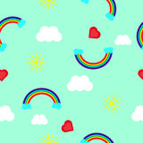 Rainbow, heart, sun and clouds on a blue background Royalty Free Stock Image