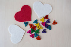 Rainbow hearts with felted red and white hearts Royalty Free Stock Photography