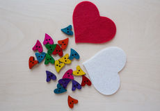Rainbow hearts with felted red and white hearts Royalty Free Stock Photos