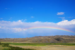 Rainbow in the hills Royalty Free Stock Images