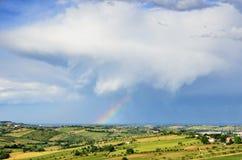 Rainbow at horizon Stock Images