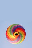 Rainbow hot air balloon Stock Images