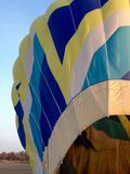 Rainbow hot air balloon Stock Image