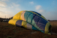 Rainbow hot air balloon Stock Images