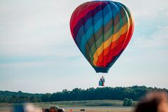 Free Rainbow Hot Air Balloon Landing During An Airshow Stock Images - 180998454