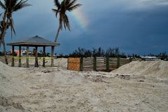 Rainbow hovers in sky over destroyed beach in Marathon Key after Hurricane Irma. Rainbow hovers in sky over Sombrero Beach in Marathon Key after destruction from Stock Photography
