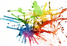 Rainbow hued splatters Royalty Free Stock Images