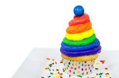 Rainbow icing on cupcake with gumball Royalty Free Stock Photo