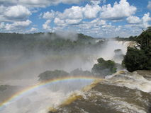 Rainbow and Iguazu Falls Stock Photo