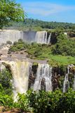 Rainbow at Iguazu Falls viewed from Brazil Stock Photo