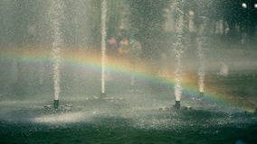 The rainbow inside of park fountane. Slowmotion stock video