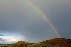 Rainbow in Ireland. Rainbow in the sky of Ireland, near the village of Anascaul on Dingle Peninsula, county Kerry, Munster Province Stock Images