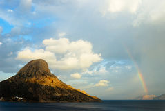 Rainbow on an Island Royalty Free Stock Photos