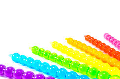 Rainbow Jelly Pops. An assortment of rainbow colored jelly popsicles Royalty Free Stock Photography