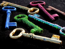 Rainbow keys. Old keys in the new clothes on a dark background, very colorful, disco style Royalty Free Stock Photo