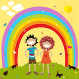 Rainbow and kids. Smiling couple underneath a rainbow Royalty Free Stock Images