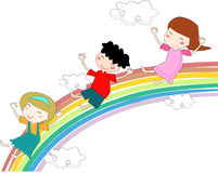 Rainbow kids. Little kids play over a rainbow Royalty Free Stock Image