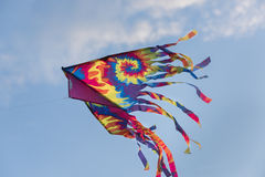 rainbow kite flying with sky background Stock Image