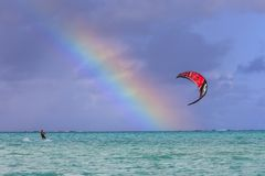 Rainbow and kite surf in Polynesia Royalty Free Stock Photo