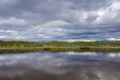Rainbow at Lake Mahinapua Royalty Free Stock Photos