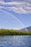 Rainbow on the lake Royalty Free Stock Image