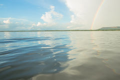 Rainbow on the lake Royalty Free Stock Photos
