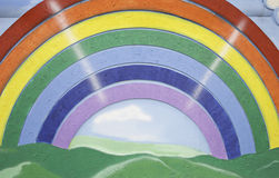 Rainbow and landscape. Rainbow colors and landscape drawings on the wall, art deco Stock Photo